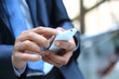 Leinwandbild Motiv Close up of a man using mobile smart phone