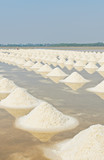 Sea salt piles in evaporation pond, Thailand