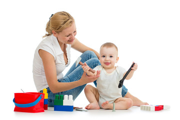 baby boy and mother playing together with construction set toy