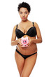 Young beautiful pregnant woman holding a pink piggybank