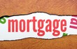 Mortgage text on torn paper