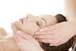 Woman enjoy receiving face massage