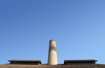 Chimney and roof in an old industrial plant