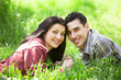 Couple Relaxing on Green grass