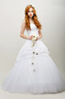 Redhaired Bride in White Bridal Dress. Wedding Fashion
