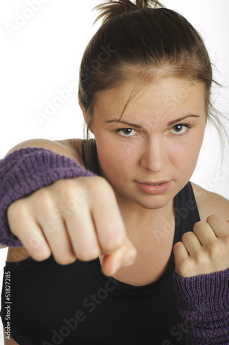 Young attractive woman showing boxing motion