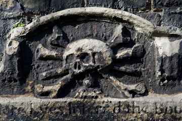 Skull & Crossbones Carving on a Gravestone