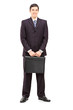Full length portrait of a young businessman with a briefcase pos