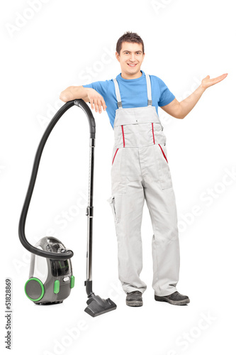 Full length portrait of a cleaning service employee posing with