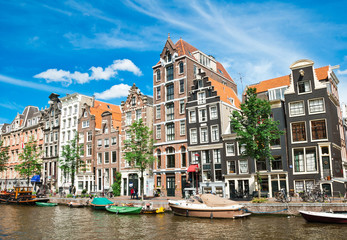 Amsterdam canals and typical houses with summer sky