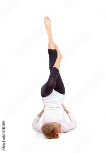 Gymnast girl in flexible back pose, isolated on white background