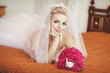 Beautiful bride in wedding dress with bouquet bridal flowers