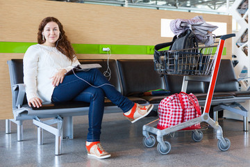 People waiting flight departure in airport lounge