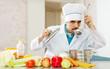 Caucasian handsome cook tasting veggie soup