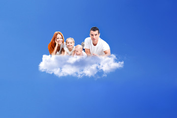family resting on a cloud