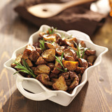 rosemary herb potatoes in white baking dish.