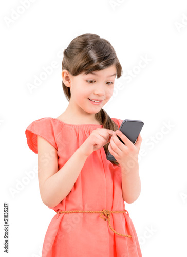 Surprised girl texting on her mobile phone