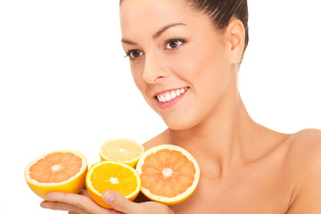 young healthy smiling woman with orange and lemons