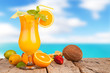 Fresh summer drink on wooden table with blur sea background
