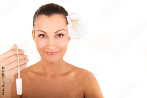 woman holding vaginal tampon