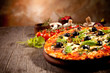 Delicious fresh pizza served on wooden table - 51836484