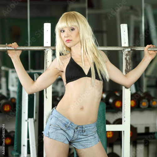 Attractive blonde fitness model in the gym