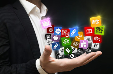Man holding shopping mobile applications