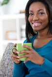 African woman enjoying in coffee