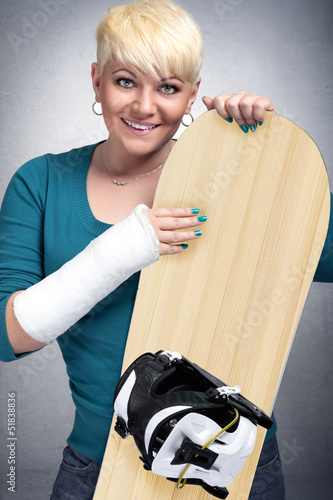 snowboarder   with arm in cast