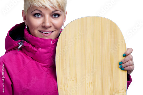 Cheerful young woman with snowboard