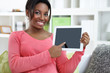 Cheerful woman showing digital tablet