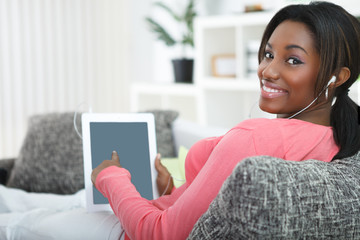 Smiling woman pointing in tablet