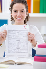 Teenager girl  holding test paper with result