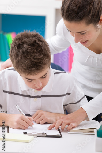 sister and  brother doing  homework together