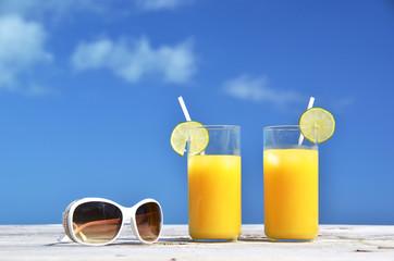 Sunglasses and orange juice
