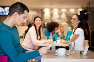 Group of girl watching handsome man in cafe