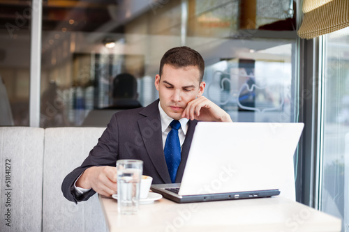 thinking businessman on coffee break