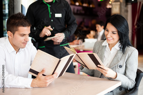 smiling couple orders a meal