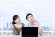 Asian couple looking up in office