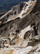 Marble quarry with hairpin bends mountain roads - Italy industry