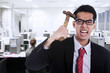 Frustrated businessman at workplace