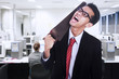 Frustrated businessman cutting his neck