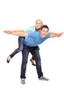 Full length portrait of  a happy young couple posing piggyback