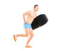 Full length portrait of a male surfer holding a surfboard and ru