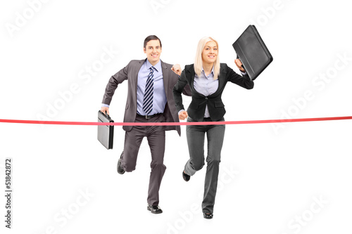 Full length portrait of a businesspeople running towards a finis