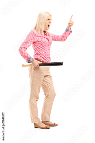 Full length portrait of a violent young woman holding a baseball