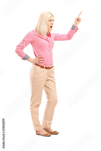 Violent young woman shouting and pointing with finger