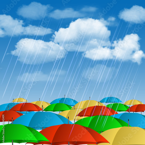 Colorful umbrellas in rain.