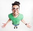 funny man with hipster glasses showing his palms and smiling