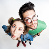pretty couple dressed casual making funny faces - wide angle